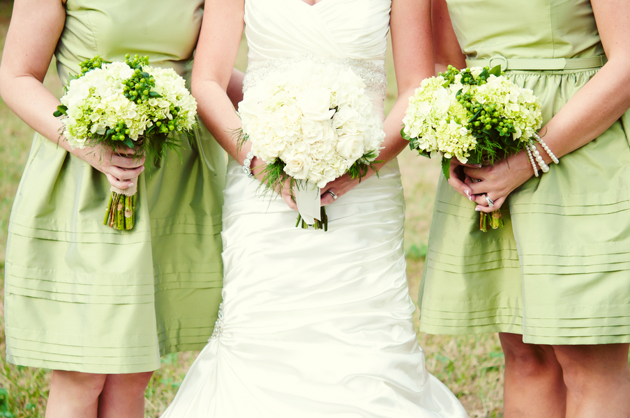 Bride and bridesmaids green and white bouquets