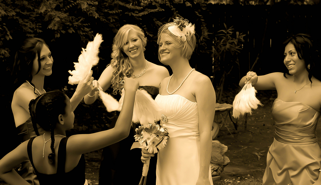 bridesmaids with feather fans